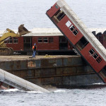 New York City subway cars being dropped offshore from barge.
